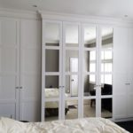 bedroom built in cupboards with mirror