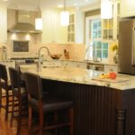 cream kitchen cabinets dark island