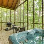 screened in deck with hot tub